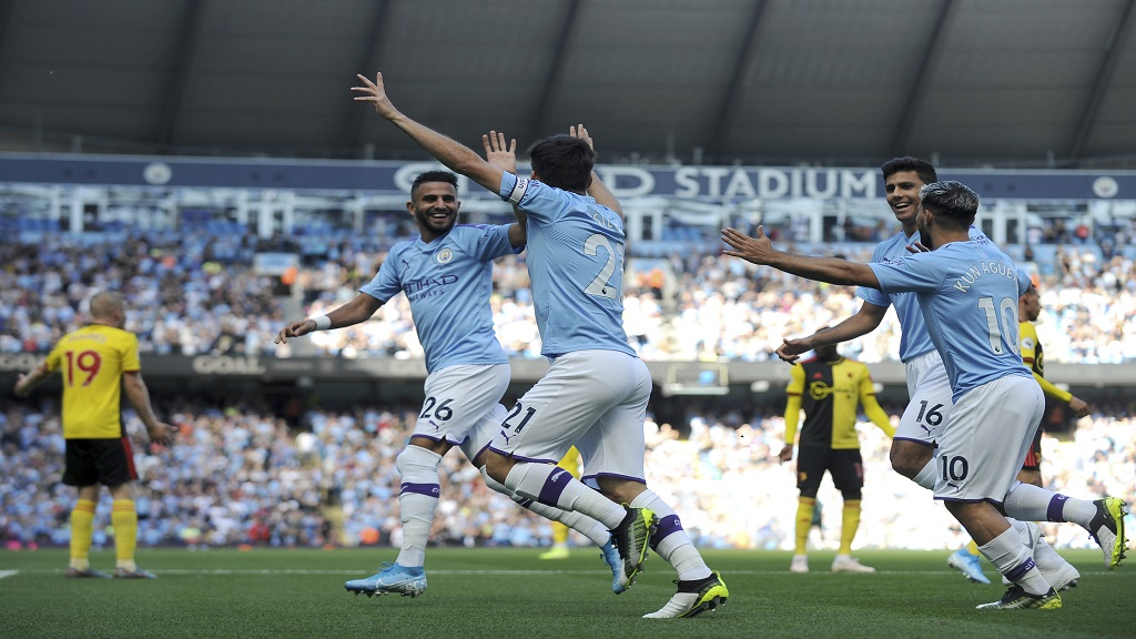Manchester City's David Silva, centre, celebrates with teammates after scoring his sides first goal during the English Premier League football match against Watford at Etihad stadium in Manchester, England, Saturday, Sept. 21, 2019.