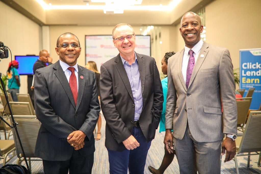 Courtney Campbell, President & CEO – Victoria Mutual Group (left) and ; Devon Barrett, Group Chief Investment Officer & Head of the Strategic Investments Unit – VM Group (right) are all smiles with Mark Young, CEO & Co-founder – Carilend Limited (centre) at the recently held Acquisition Announcement by VM Investment Limited.