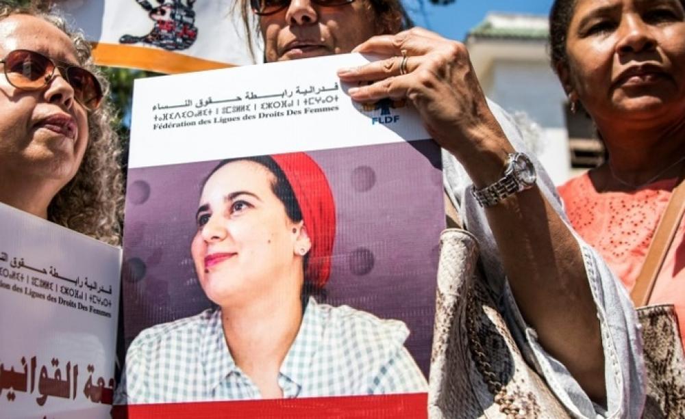 """Des manifestantes brandissent des portraits de la journaliste marocaine Hajar Raissouni, jugée pour """"avortement illégal"""", le 9 septembre à Rabat afp.com - FADEL SENNA"""