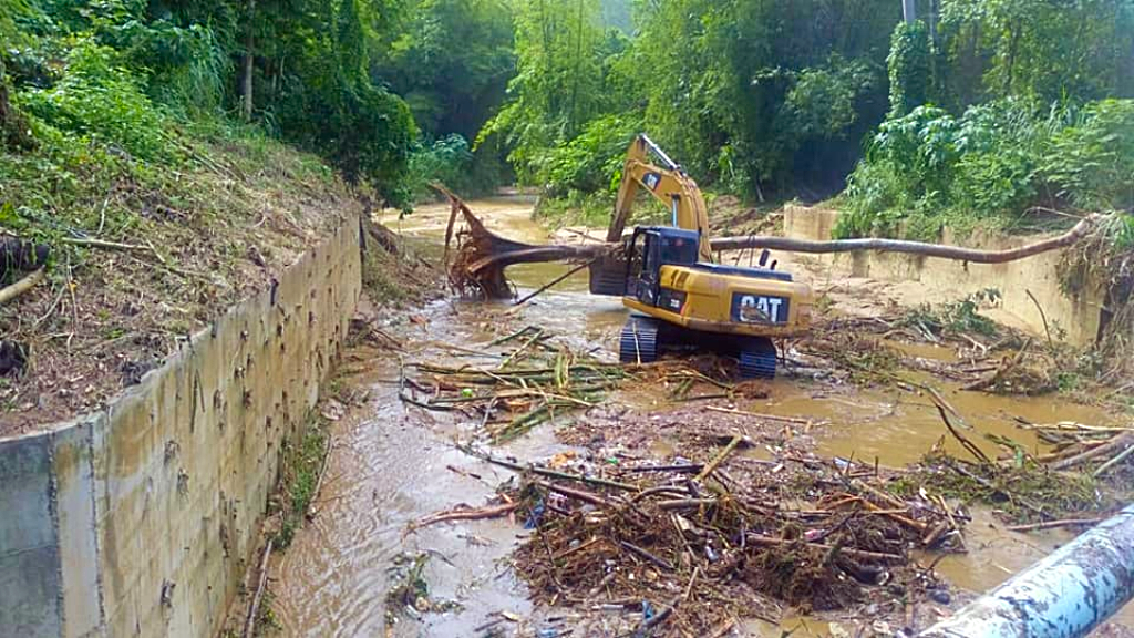 Photo: Clean-up efforts in the Santa Cruz River and Tacarigua River,Trantrail Road, St Augustine. Photo courtesy the Ministry of Works and Transport.