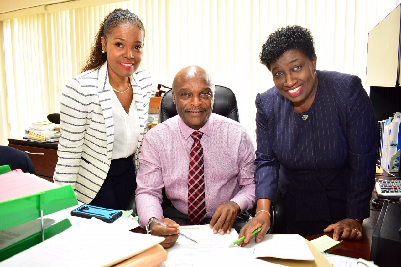 New Comptroller of Customs Owen Holder is pictured with deputies Cheryl-Ann Cumberbatch (left) and Sonea Jordan-Clarke. (C.Pitt/BGIS)