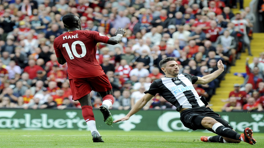 Liverpool's Sadio Mane, left, after scoring his sides second goal during the English Premier League football match against Newcastle at Anfield stadium in Liverpool, England, Saturday, Sept. 14, 2019. (AP Photo/Rui Vieira).