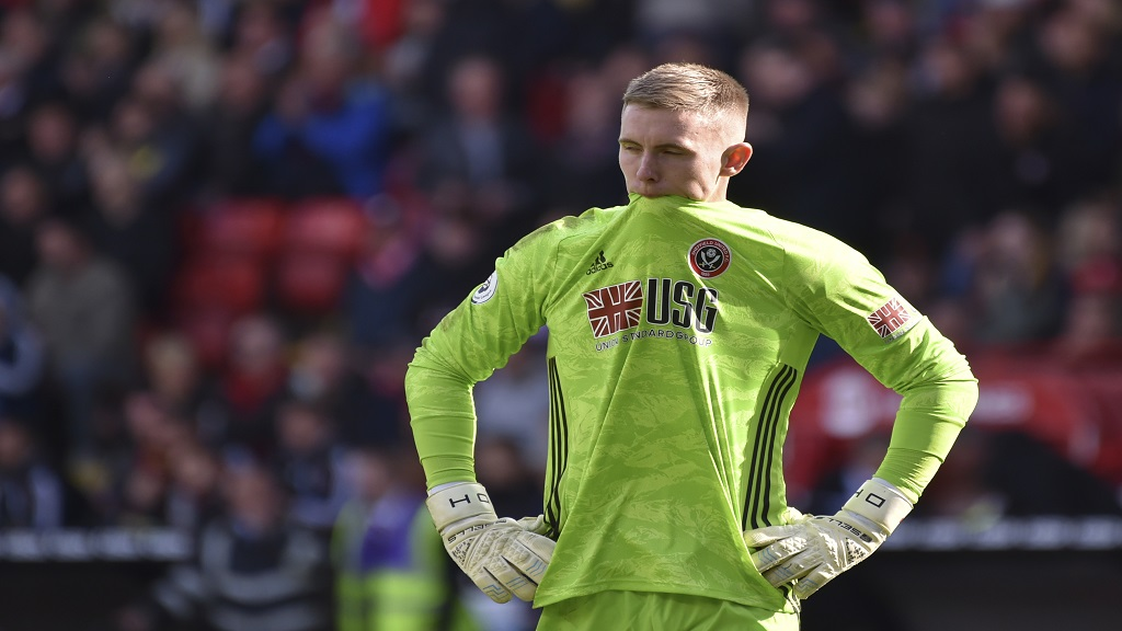 Sheffield United's goalkeeper Dean Henderson reacts during the English Premier League football match against Liverpool at Bramall Lane in Sheffield, England, Saturday, Sept. 28, 2019. (AP Photo/Rui Vieira).