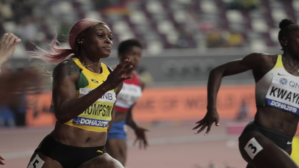 Elaine Thompson of Jamaica competes in the women's 200m heat at the World Athletics Championships in Doha, Qatar, Monday, Sept. 30, 2019. (AP Photo/Nariman El-Mofty).