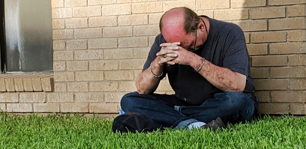 A man prays outside of the Medical Center Hospital Emergency room in Odessa, Texas, Saturday, Aug. 31, 2019, following a shooting at random in the area of Odessa and Midland. Several people were dead after a gunman who hijacked a postal service vehicle in West Texas shot more than 20 people, authorities said Saturday.