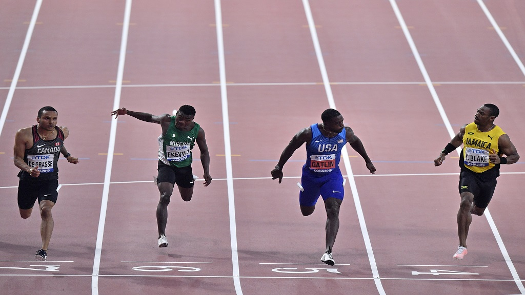 Andre De Grasse, of Canada, Raymond Ekevwo, of Nigeria, Justin Gatlin, of the United States, and Yohan Blake, of Jamaica, from left, compete in a men's 100 metre race semifinal during the World Athletics Championships in Doha, Qatar, Saturday, Sept. 28, 2019. (AP Photo/Martin Meissner).