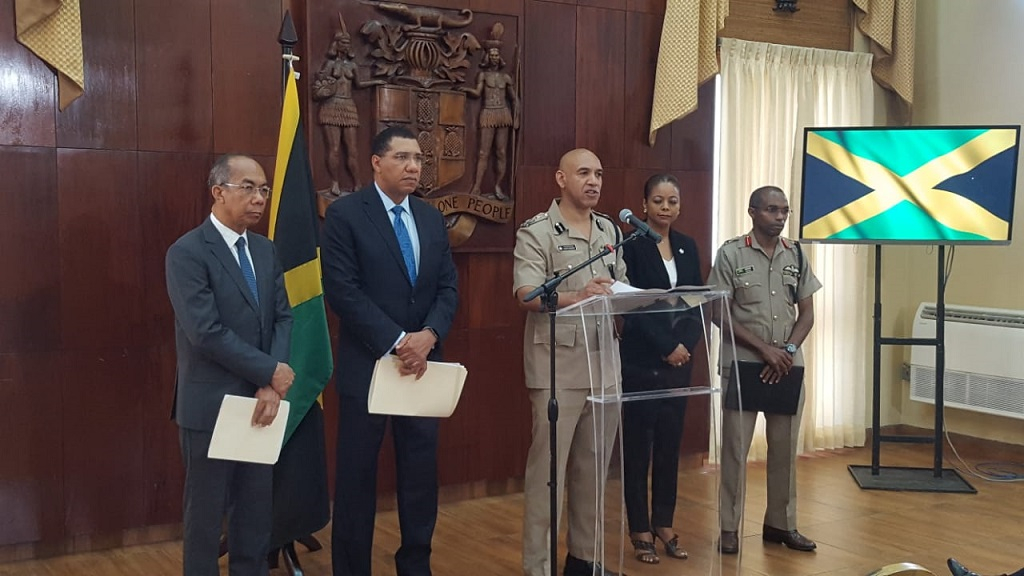 Police Commissioner Major General Antony Anderson addresses journalists at a press conference Tuesday to announce states of emergency in Clarendon and St Catherine. Also pictured (from left) are National Security Minister Horace Chang; Prime Minister Andrew Holness; Attorney General Marlene Malahoo Forte and Chief of Defence Staff Lieutenant General Rocky Meade.
