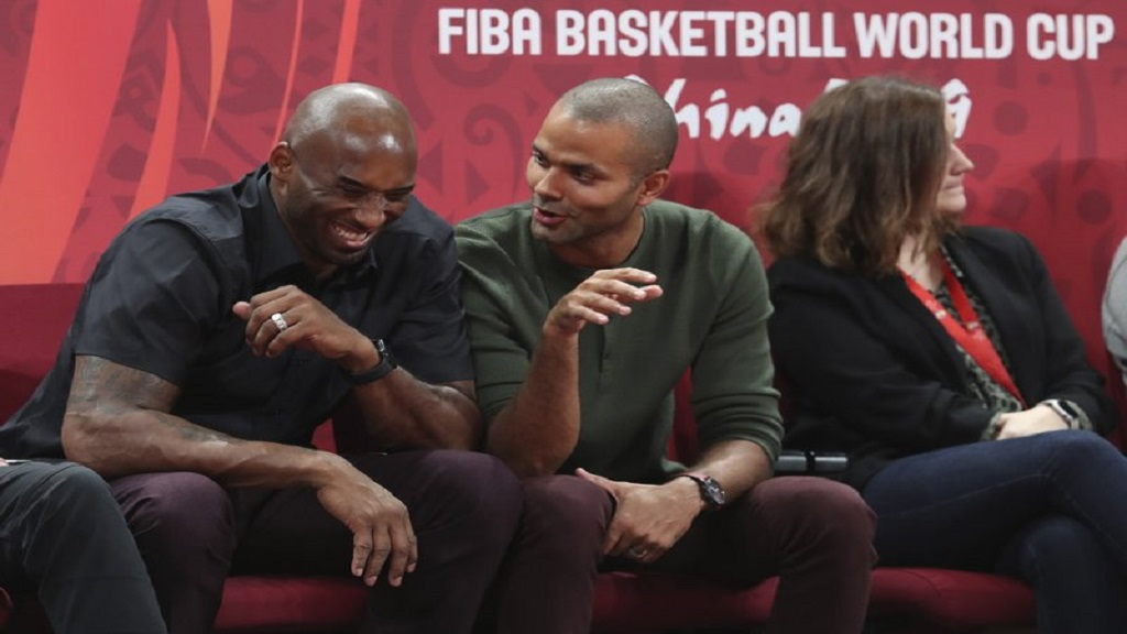Former NBA players, Kobe Bryant (left) and Tony Parker, talk during the first-place match between Spain and Argentina in the FIBA Basketball World Cup at the Cadillac Arena in Beijing on Sunday, September 15. (AP Photo/Ng Han Guan)