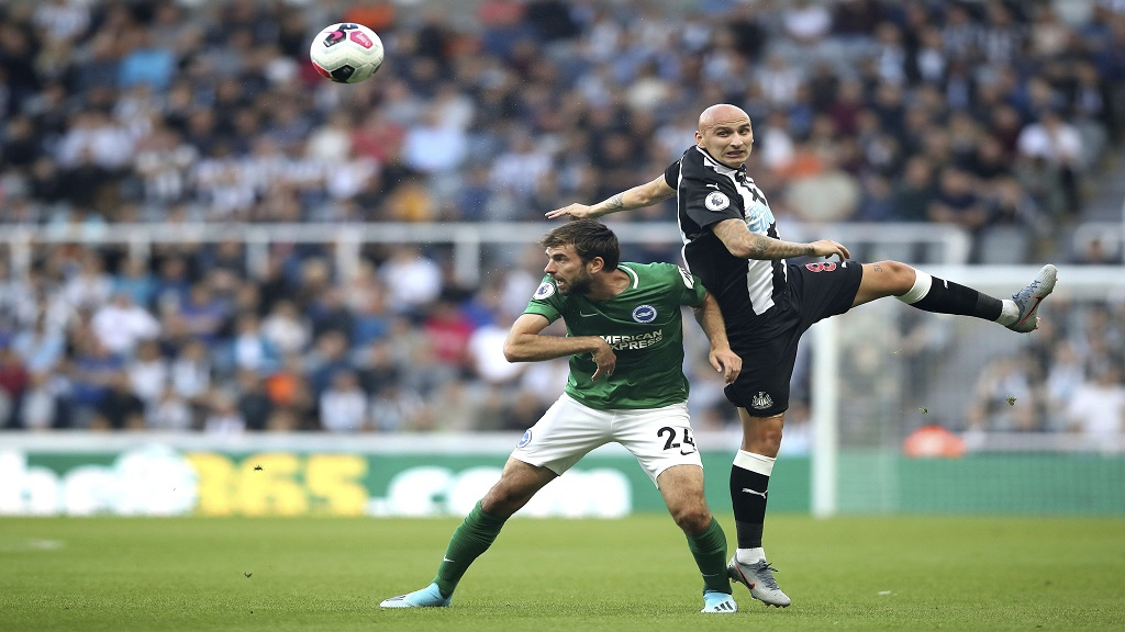 Brighton and Hove Albion's Davy Propper, left, and Newcastle United's Jonjo Shelvey battle for the ball during their English Premier League match at St James' Park, Newcastle, England, Saturday Sept. 21, 2019. (Owen Humphreys/PA via AP).
