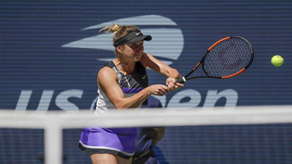 Elina Svitolina, of Ukraine, returns a shot to Johanna Konta, of the United Kingdom, during the quarterfinals of the US Open tennis championships Tuesday, Sept. 3, 2019, in New York. (AP Photo/Frank Franklin II).