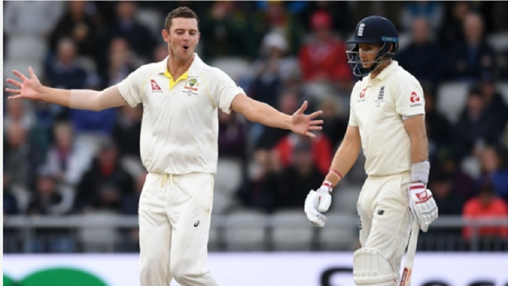 Josh Hazlewood celebrates the wicket of England captain Joe Root.