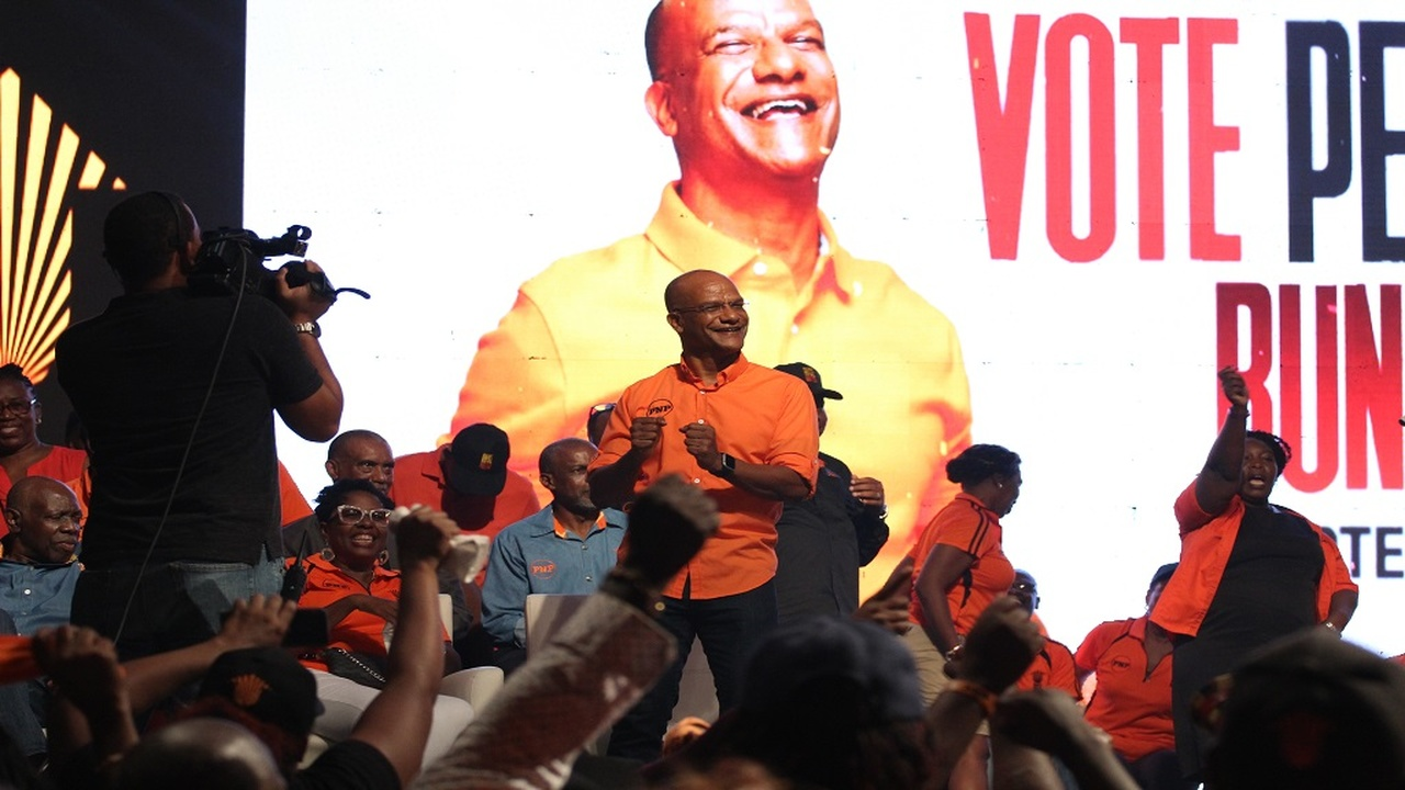 Central Manchester MP, Peter Bunting dances on stage during a PNP presidential election campaign event.
