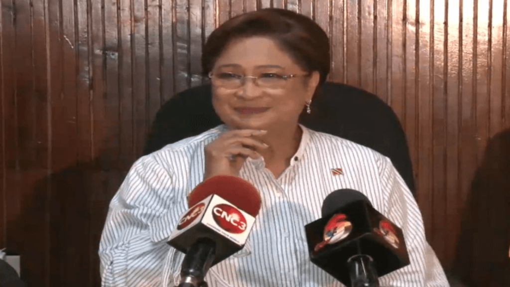 Bring it on: Opposition leader Kamla Persad-Bissessar speaks at a media conference on Thursday following the announcement of a Commission of Enquiry into the $500 million acquisition of land for the Solomon Hochoy Highway extension to Point Fortin.