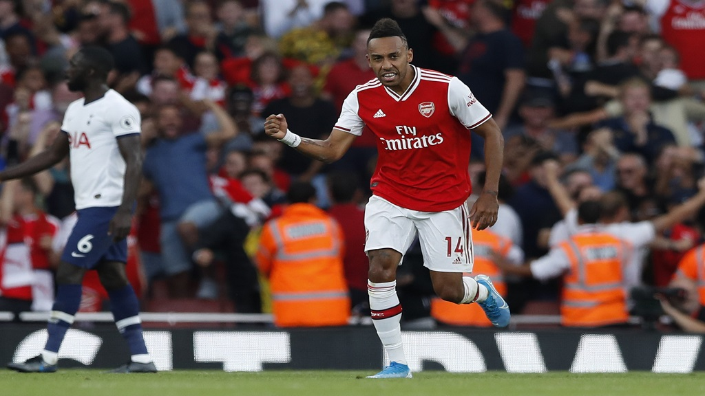 Arsenal's Pierre-Emerick Aubameyang, left, celebrates after scoring his side's second goal during their English Premier League match against Tottenham Hotspur at the Emirates stadium in London, Sunday, September 1, 2019. (AP Photo/Alastair Grant)