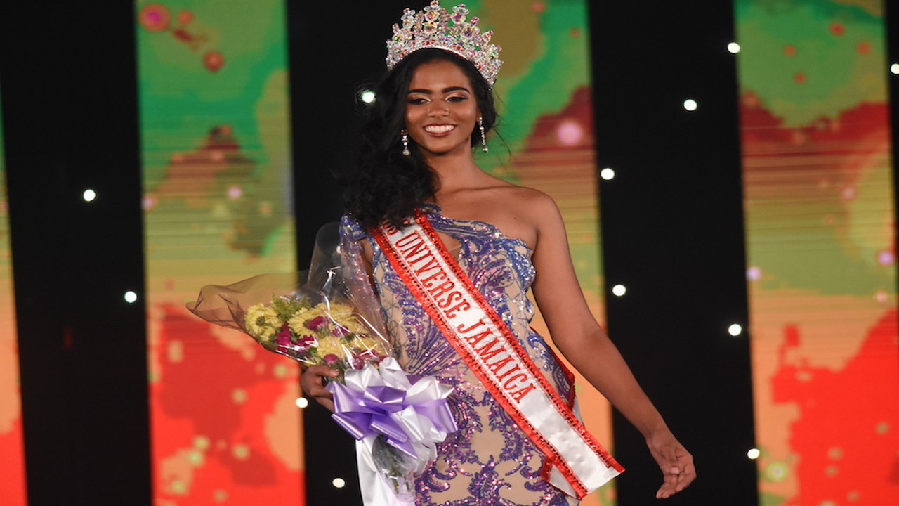Iana Tickle Gracia flashes her beautiful smile as she soaks up being crowned Miss Jamaica Universe at the National Arena in Kingston on Saturday. (PHOTOS: Marlon Reid)