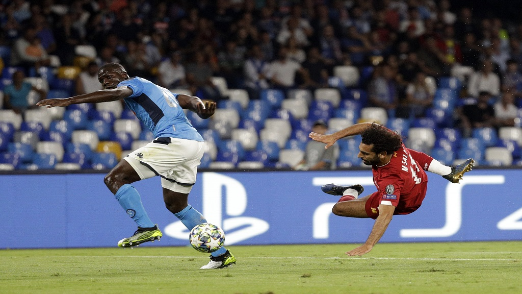 Liverpool's Mohamed Salah, right, tries to score as Napoli's Kalidou Koulibaly defends during the Champions League Group E football match at the San Paolo stadium in Naples, Italy, Tuesday, Sept. 17, 2019. (AP Photo/Gregorio Borgia).