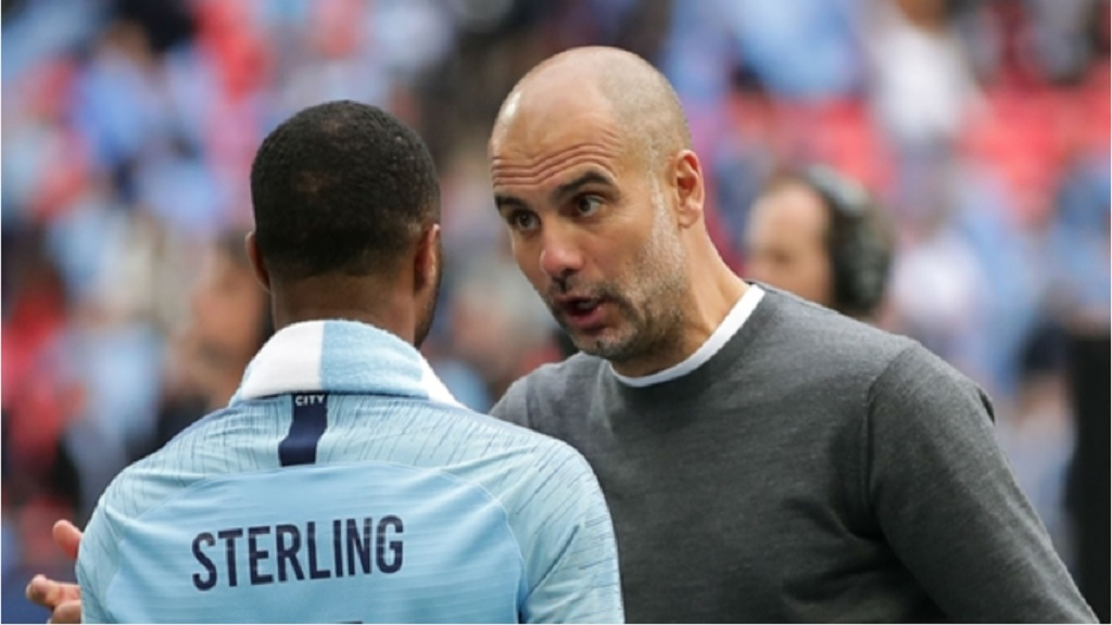 Pep Guardiola and Raheem Sterling.