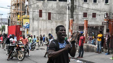 Un homme participe à une manifestation contre le président haïtien Jovenel Moïse à Port-au-Prince, le 25 septembre 2019  afp.com - CHANDAN KHANN