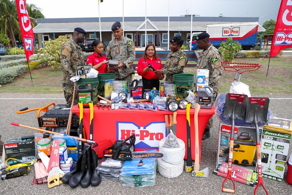Hi Pro Store Operations Manager, Tricia Jackson (3rd right) show some of the donated supplies to Captain McKenzie (2nd right) and Warrant Class Officer 2 Finley; meanwhile Hi Pro Marketing Officer, Justine Bailey (2nd left) show some of the equipment to Sergeant Hunt (left) and Captain Beckford (2nd left).
