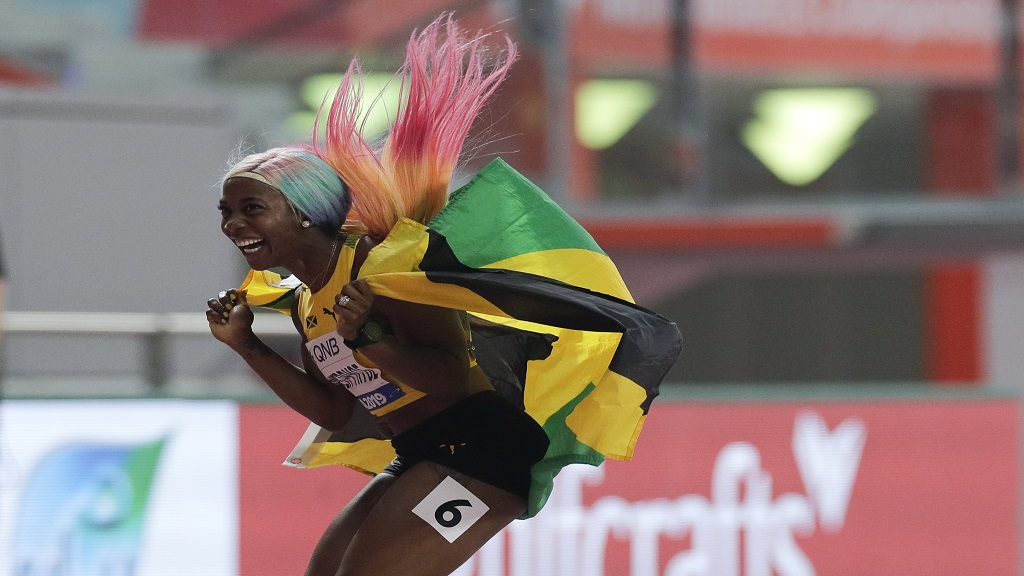 Shelly-Ann Fraser-Pryce, of Jamaica celebrates after winning the gold medal in the women's 100m final at the World Athletics Championships in Doha, Qatar, Sunday, Sept. 29, 2019. (AP Photo/Petr David Josek).