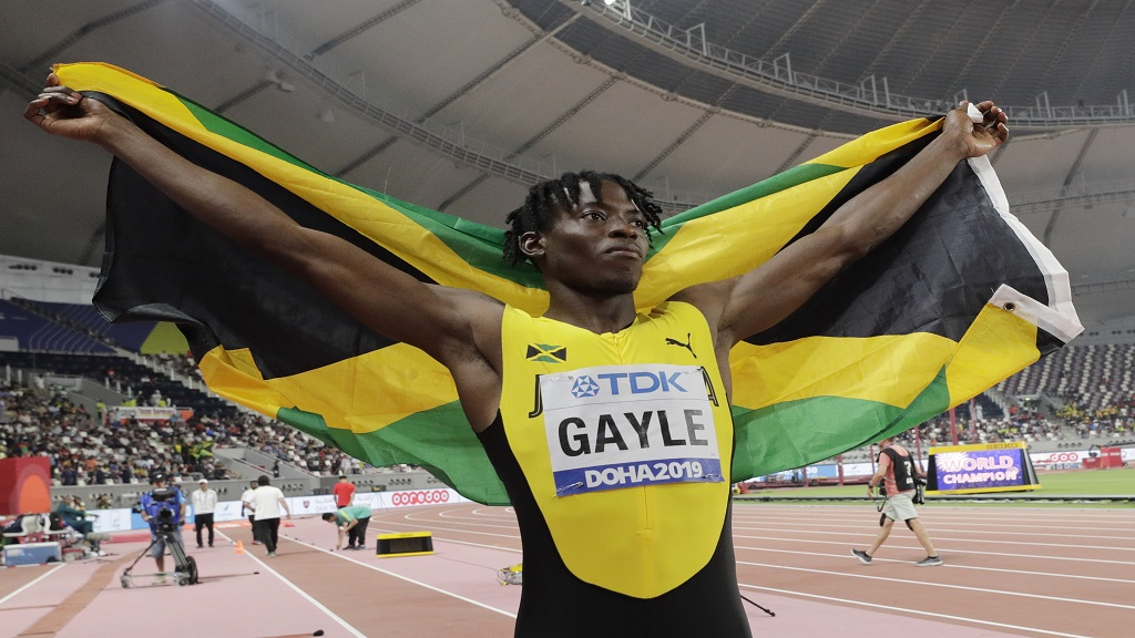 Tajay Gayle, of Jamaica, celebrates winning the gold medal for men's long jump at the World Athletics Championships in Doha, Qatar, Saturday, Sept. 28, 2019. Gayle won the gold medal. (AP Photo/Hassan Ammar).