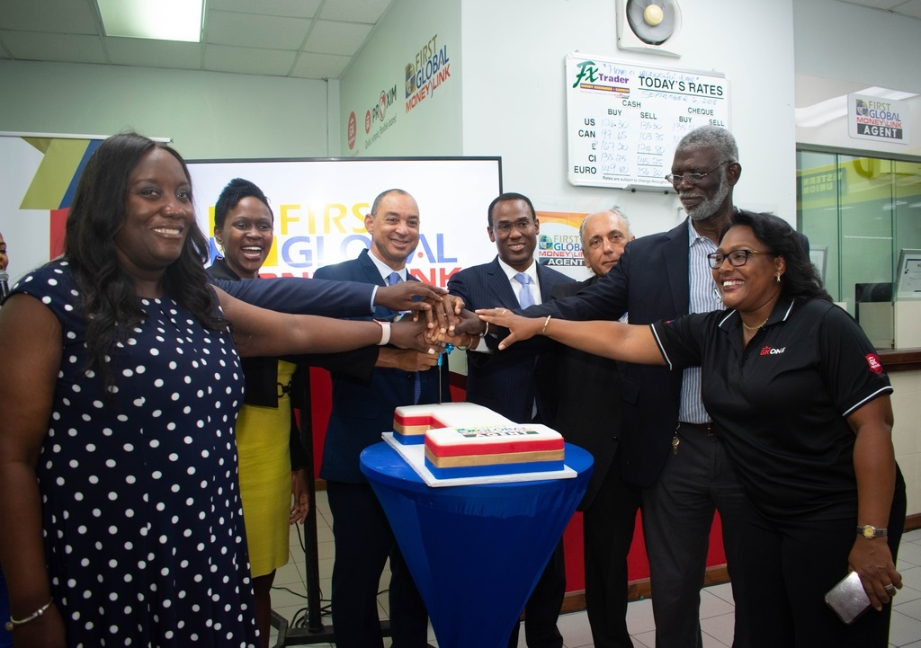Mariame McIntosh Robinson, chief executive officer (CEO) and president, First  Global Bank Limited (FGB); Senator Don Wehby, group CEO, GraceKennedy Limited (GKL); Nigel Clarke, minister of finance; Mr Peter Moses, FGB's chairman; Clinton Brissett, agent opwner; and Grace Burnett, CEO, GraceKennedy Financial Group at FGB's launch of Jamaica's first banking agent at the Boulevard Supercentre last year.