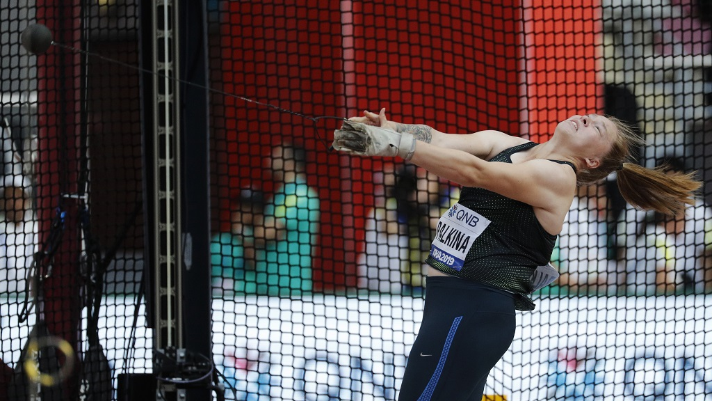Sofiya Palkina, competing as a neutral athlete, competes during the women's hammer throw qualifying round at the World Athletics Championships in Doha, Qatar, Friday, Sept. 27, 2019. (AP Photo/Hassan Ammar).