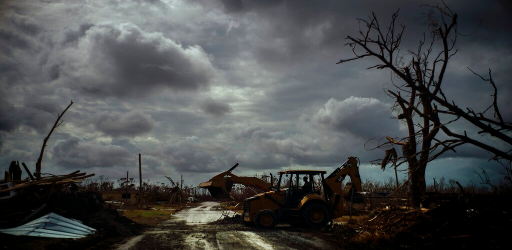 Mos Antenor, 42, drives a bulldozer while clearing the road after Hurricane Dorian Mclean's Town, Grand Bahama, Bahamas, Friday Sept. 13, 2019.