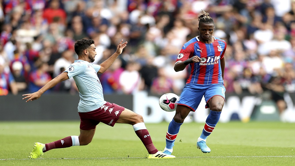 Crystal Palace's Wilfried Zaha in action during their English Premier League football match against Aston Villa at Selhurst Park, London, Saturday, Aug. 31, 2019. (Bradley Collyer/PA via AP).