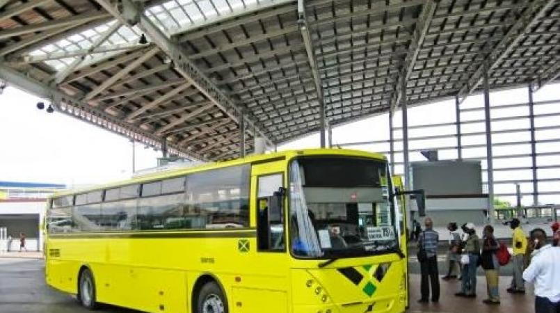 File photo of passengers boarding a JUTC bus at the Half Way Tree Transport Centre in St Andrew.