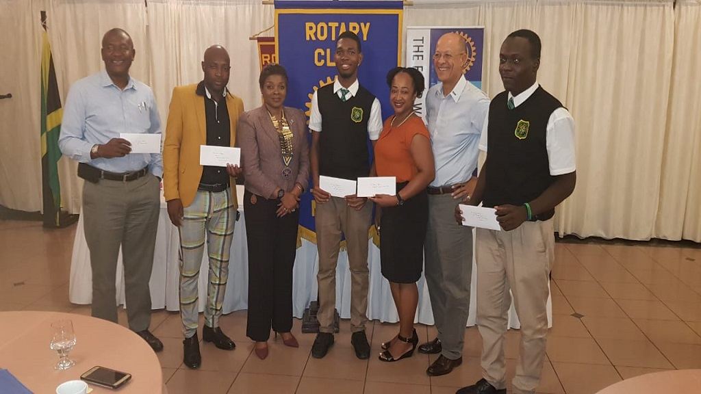 From left: Glaister Ricketts, Director Rotary Club of St. Andrew North Education Foundation; Kieron Mitchell, father of a recipient; Annmarie Curtis, President Rotary Club of St Andrew North; Ian Wright, President,  Calabar Interact Club and recipient;  Janelle Gray, Faculty Advisor at Immaculate High School Interact Club, Donald Patterson, Director, Rotary Club of St Andrew North Education Foundation and Ricardo Brown, recipient.