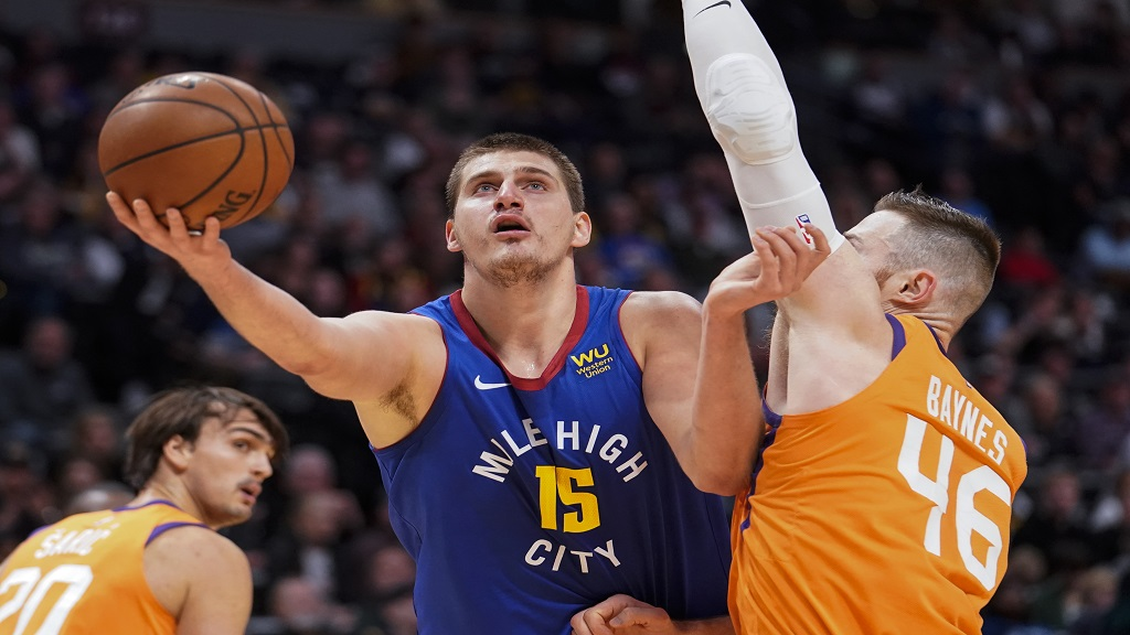 Denver Nuggets center Nikola Jokic (15) looks to shoot against Phoenix Suns center Aron Baynes (46) during the first quarter of an NBA basketball game, Friday, Oct. 25, 2019, in Denver. (AP Photo/Jack Dempsey).