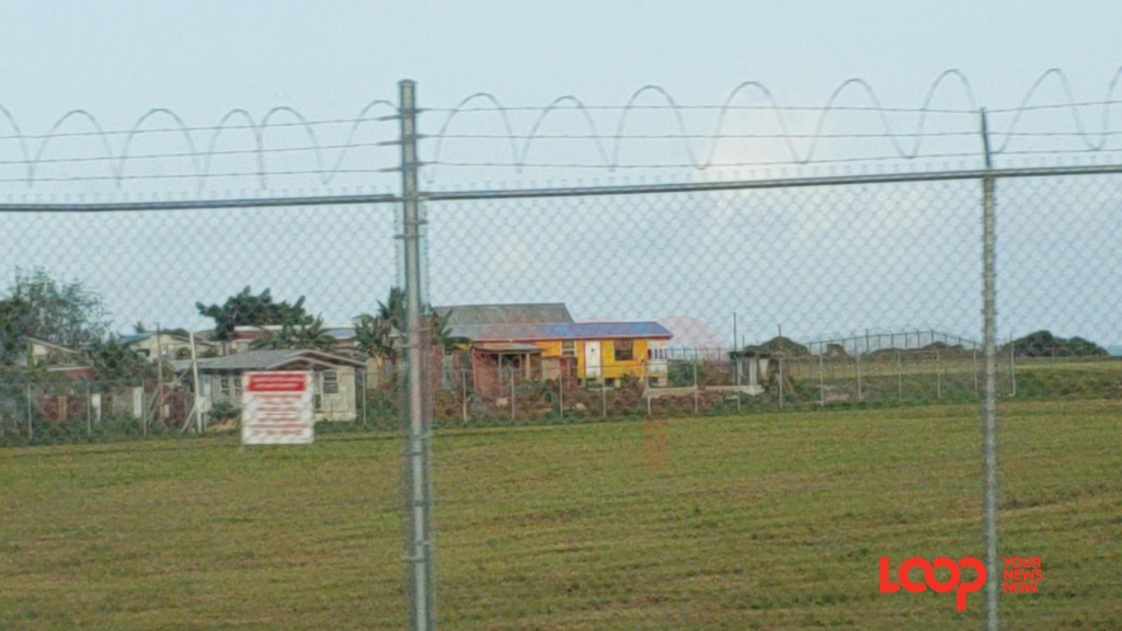 Squatters in Rock Hall near the perimeter of the Grantley Adams International Airport.