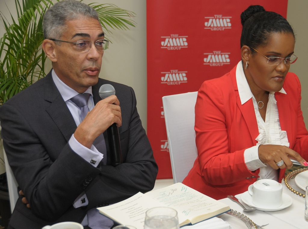 Bank of Jamaica Governor Richard Byle (left) makes a point during the JMMB Thought Leadership Breakfast. To  his right is Kerry-Ann Stimpson, JMMB's group chief marketing officer.