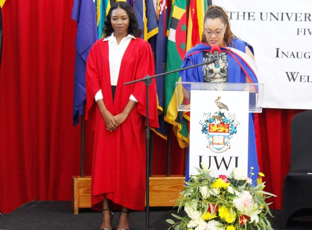 Antiguan scholar and top matriculant for 2019-2020, Kayah M. Ward [left] is presented by Director of Administration and Finance at the Five Islands Campus, Daniella Hickling [right] at the Campus' Matriculation Ceremony on 27 September, 2019.