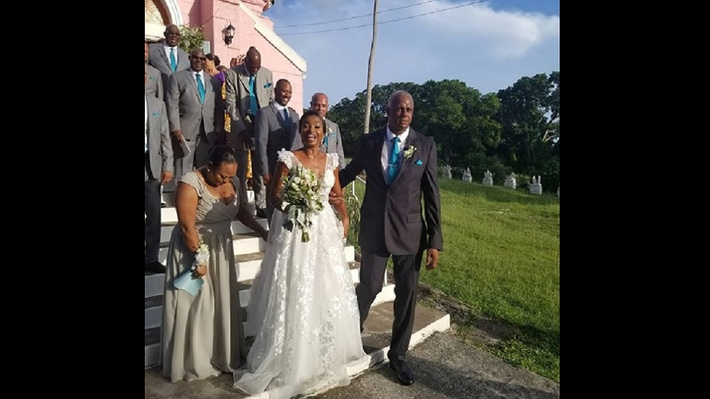 Courtney Walsh with his bride, Anique Goodwin, at their wedding ceremony in Antigua last weekend. (Photo: Walshy Fire Instagram)