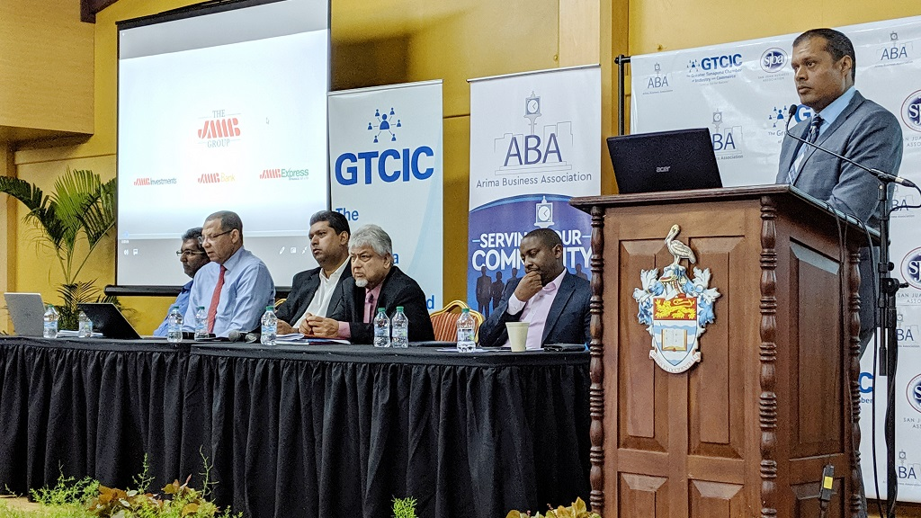 (Photo: Economist Dr Roger Hosein, former minister in the ministry of finance Mariano Browne, former energy minister Kevin Ramnarine, Caroni Central MP Bhoendradath Tewarie, Elson James, CEO JMMB Express Finance, and GTCIC President Vivek Charran discuss budget concerns.)
