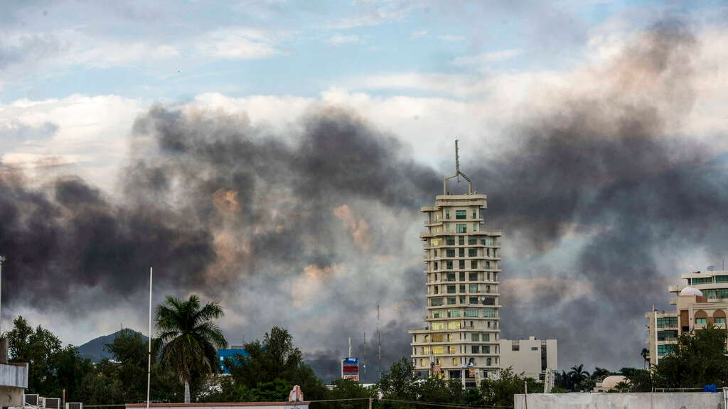 Smoke from burning cars rises due in Culiacan, Mexico, Thursday, October 17, 2019.  (AP Photo/Hector Parra)