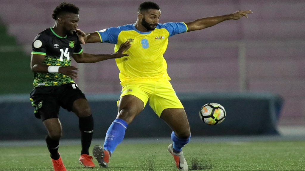 Shaun Francis of Jamaica (left) and Clyde Groothusen of Aruba fight for the ball in their return leg Group C game of League B of the Concacaf Champions League at the Ergilio Hato Stadium in Willemstad, Curacao on Tuesday October 15, 2019.