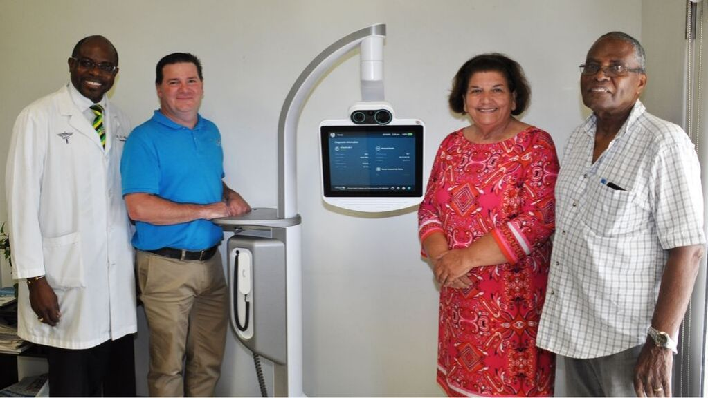 HSA Medical Director Dr. Delroy Jefferson, Intouch Health Specialist Manager Shawn Quebedeaux, Intouch Health Agent for the Caribbean Region Carole Appleyard and VP of the Cayman Islands Seafarers Association John Douglas with the next generation InTouch Health RP-Lite 4 telemedicine robot.