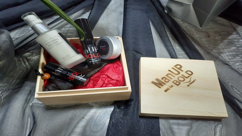The ManUP and be Bold box set complete with four mattifying products and a leather travel pouch.
