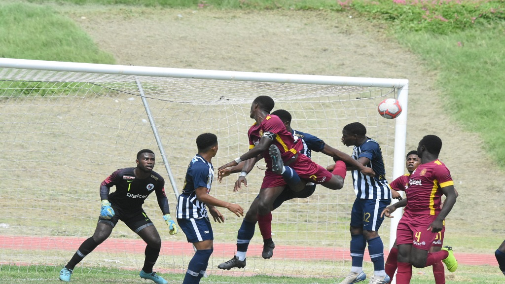 Jamaica College's goalkeeper Daniel Russell watches an aerial ball during the remaining eight minutes of the urban area Manning Cup match against Wolmer's at Stadium East on Wednesday, October 16, 2019. Wolmer's were leading 2-1 on September 16 but the game was called off in the 82nd minute after five players were struck by lightning. The game ended 2-2.  (PHOTO: Marlon Reid).