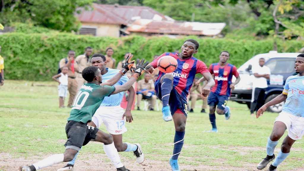 Goalkeeper Raheem Henry (left) of St Catherine High challenges a St Andrew Technical High (STATHS) striker during their  Group C top-of-the-table ISSA/Digicel Manning Cup game at STATHS on Friday, October 4, 2019. (PHOTOS: Marlon Reid).