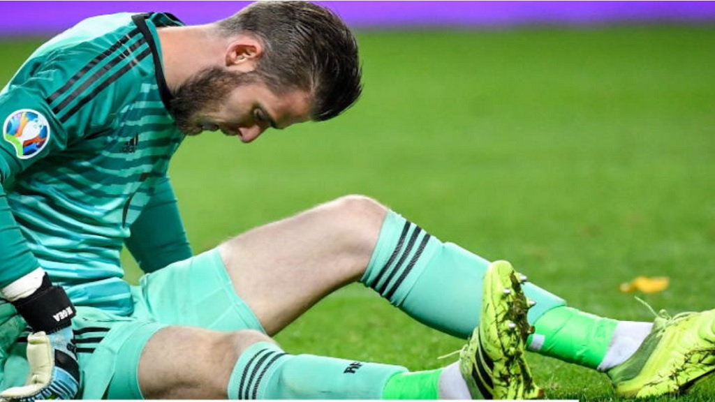 Spain's goalkeeper David de Gea reacts after picking up an injury in their Euro 2020 qualification-sealing draw in Sweden on Tuesday.