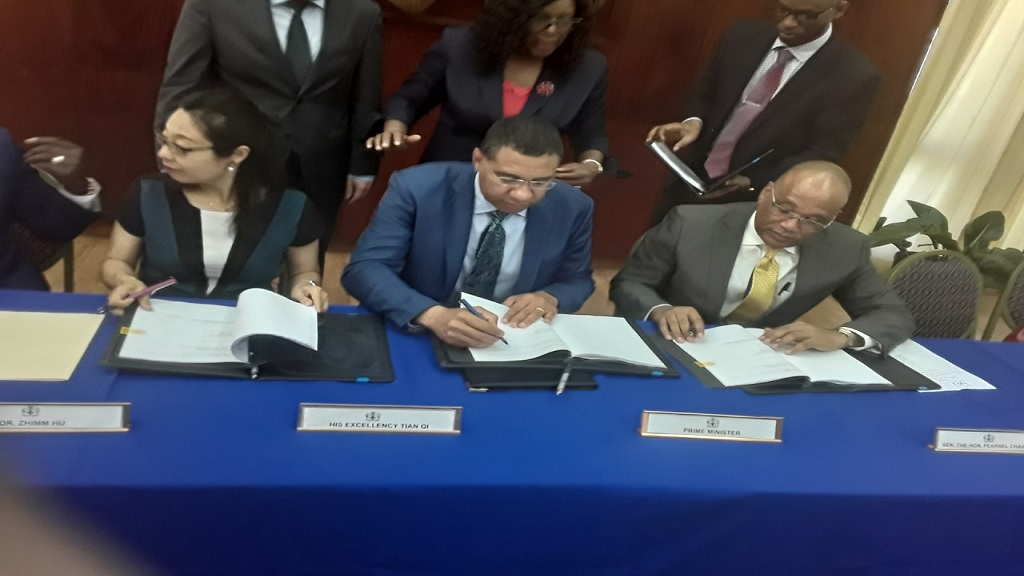 Prime Minister Andrew Holness (centre) with President of CHEC Americas Division, DR Zhimin Hu; and HAJ Board Chairman Norman Brown at the signing ceremony held at the Office of the Prime Minister in St Andrew on Tuesday.