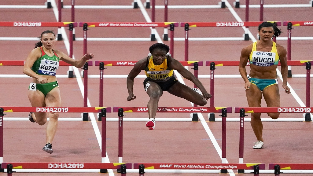 Danielle Williams, of Jamaica, wins her heat of the women's 100m hurdles at the World Athletics Championships in Doha, Qatar, Saturday, Oct. 5, 2019.  The semifinals and final will take place on Sunday's final day. Four Jamaicans are in the semifinals.(AP Photo/Morry Gash).