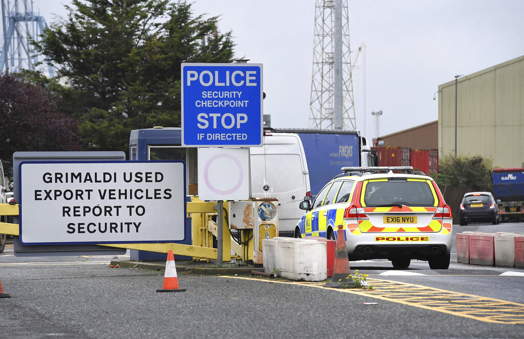 A  police car enters the Port of Tilbury, where a shipping container with 39 people is thought to have entered England, near Grays, England, October 25, 2019. (Kirsty O'Connor/PA via AP)