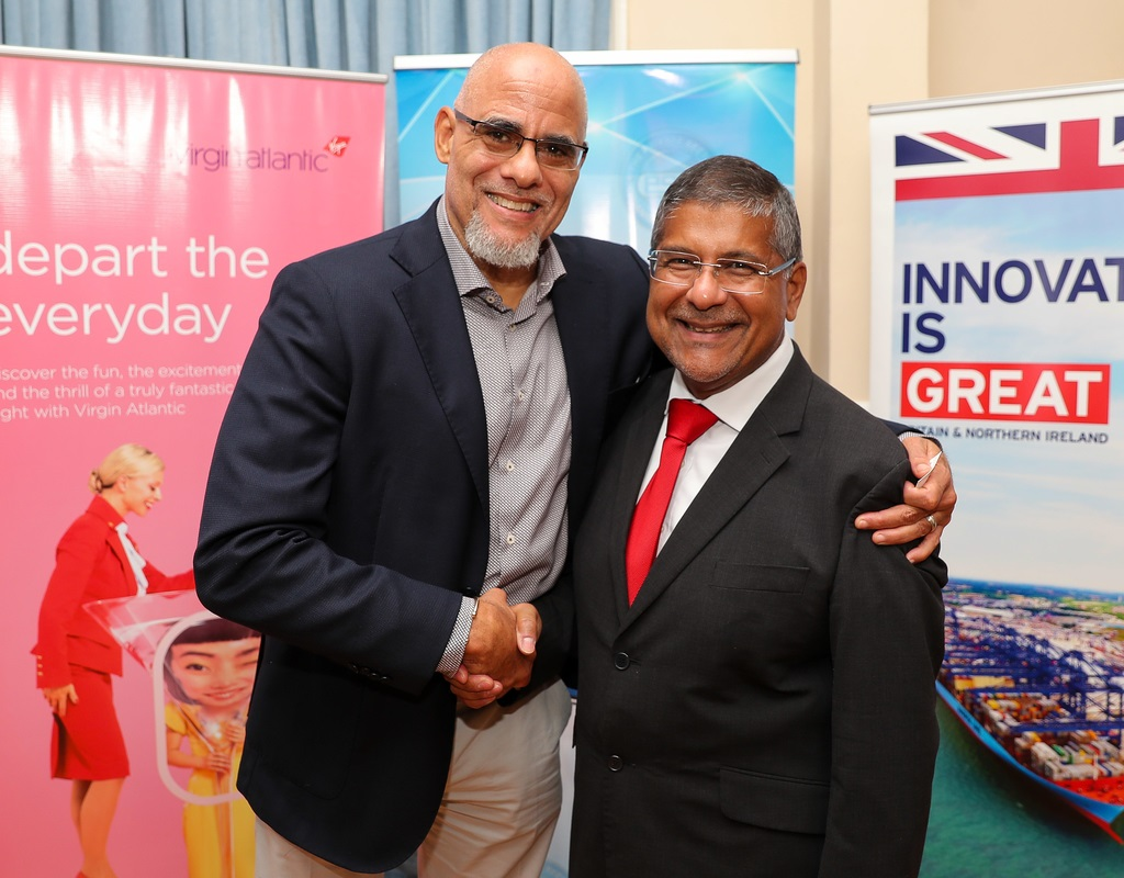 •	Newly elected President of PSOJ, Keith Duncan greets Asif Ahmad, British High Commissioner to Jamaica and Bahamas.