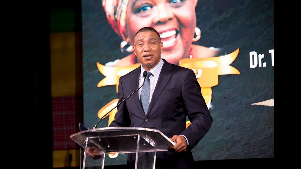 "Prime Minister Andrew Holness addressing a ceremony in Gordon Town, St Andrew, on Sunday  to commemorate the centenary of the birth of late cultural ambassador, Louise Bennett-Coverley, affectionately known as ""Miss Lou""."
