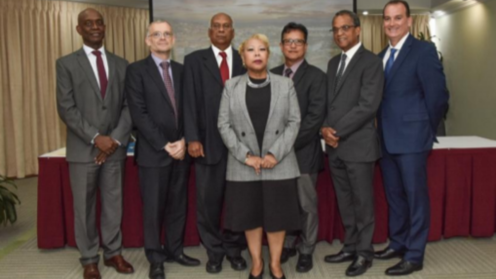 Signing of the agreements at the Central Bank of Trinidad and Tobago. Photo via Central Bank.